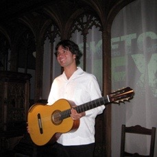 International guitarist Morgan Syzmanski playing at a Landulph Festival concert